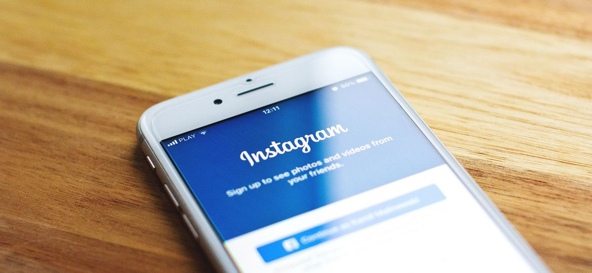 instagram on a phone on a desk